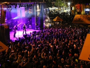 News-Journal/JIM TILLER   As the band Godsmack played at the Full Moon Saloon lot Saturday night the crowd grew so large that  Main Street had to be closed durning the concert Saturday night March 7, 2015.