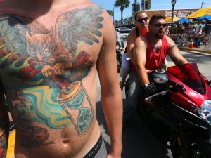 News-Journal/JIM TILLER Kody bos, from Buffalo N.Y. was showing off his tattoos on the final big day of Bike Week 2015 on Main Street in Daytona Beach Saturday , March 14, 2015.