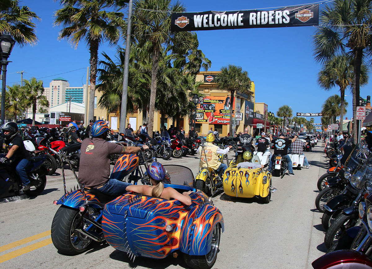 Three wheeled trikes rolls down Main Street as Bike Week 2016 rolls toward it's final weekend in Daytona Beach Wednesday, March 9, 2016. News-Journal/JIM TILLER