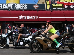 Bikers roll past Dirt Harry's on Main Street in Daytona Beach during Bike Week Saturday March 11, 2017. [News-Journal/JIM TILLER]