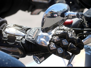 A biker with some serious gloves rides his bike down Main Street in Daytona Beach Wednesday  March 15, 2017 as Bike Week races toward it's final weekend. [News-Journal/JIM TILLER ]