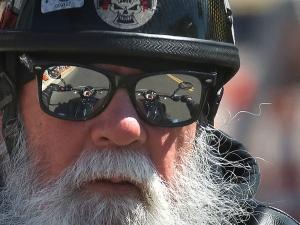 Typical biker rides down Main Street in Daytona Beach during Bike Week Wednesday  March 15, 2017. [News-Journal/JIM TILLER ]