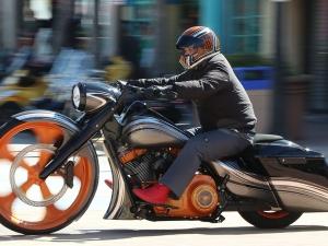 A biker rides north on A1A on a custom chopper as Bike Week 2017 rolls into it's final weekend in  Daytona Beach Friday March 17,  2017. [News-Journal/JIM TILLER ]