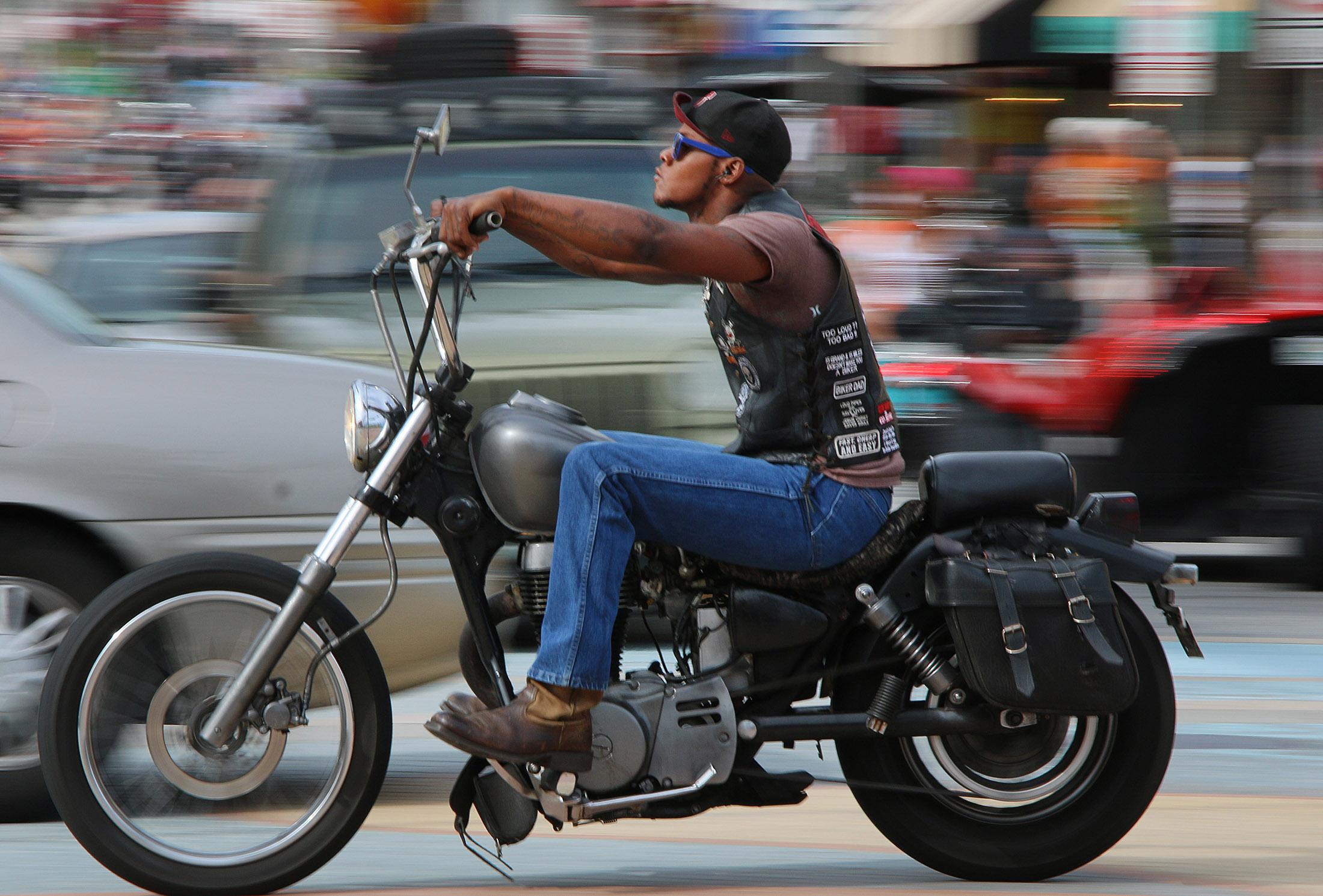 A biker streaks south on A1A as Biketoberfest rolls into day 2 in Daytona Beach Friday  October 16, 2015. News-Journal/JIM TILLER