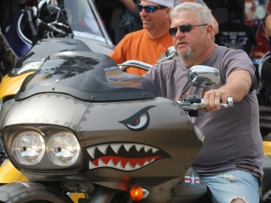 A man rides a motorcycle that might bite down Main street as Biketoberfest rolls into day 2 in Daytona Beach Friday  October 16, 2015. News-Journal/JIM TILLER