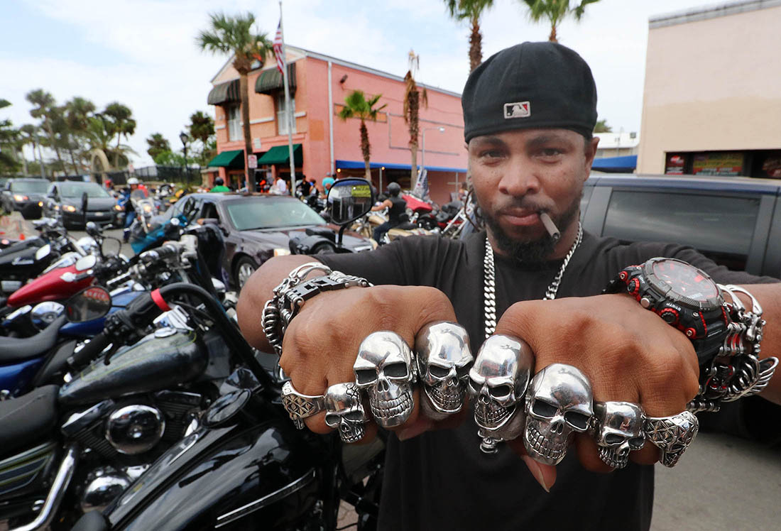 Danny Lewis, Orlando show off his collection of biker rings along Main Street in Daytona Beach on the final day of Biketoberfest Sunday October 22, 2017. [NEWS-JOURNAL/Jim Tiller]  Was interviewed by Seth