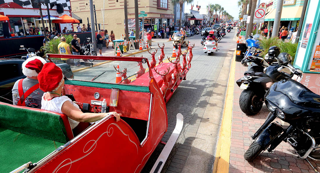 Mr. And Mrs Santa Claus rolled out their reindeer guided sleigh to parade down Main Street on the  25th Anniversary of Biketoberfest  in Daytona Beach Saturday October 21, 2017. [NEWS-JOURNAL/Jim Tiller]  WAS INTERVIEWED BY NIKKI