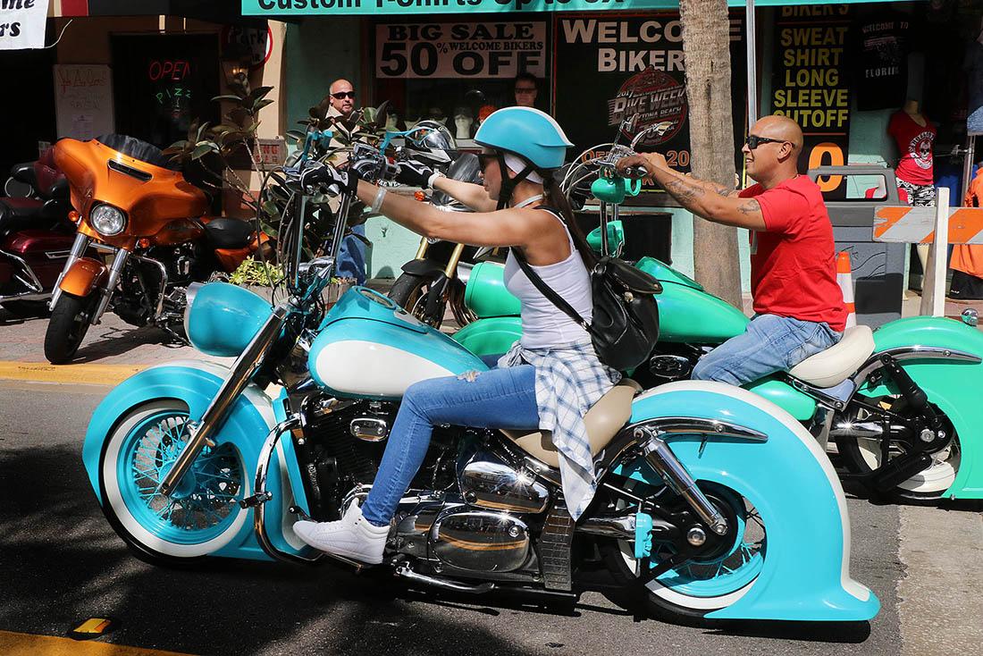 A couple ride a pair of 'Dr. Seuss' looking motorcycles down Main Street as Biketoberfest heads into the weekend in Daytona Beach Friday October 20, 2017. [NEWS-JOURNAL/Jim Tiller]