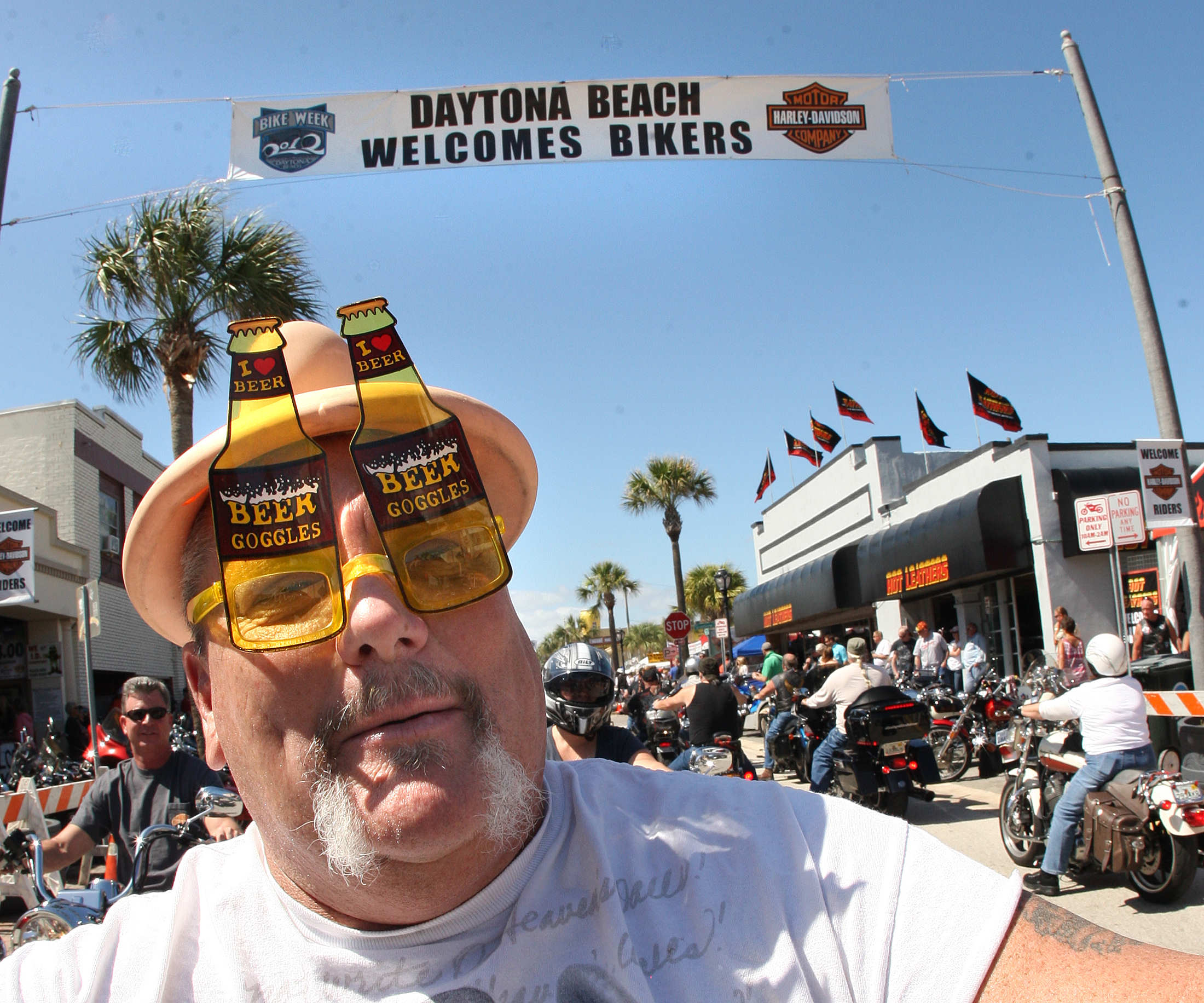 A biker sporting \'Beer Goggles\' was enjoying his ride along Main Street in Daytona Beach as Bikeweek 2012 finally had clear skys and sunny weather Monday, March 12, 2012. (Photo JIm Tiller )