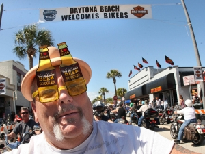 A biker sporting 'Beer Goggles' was enjoying his ride along Main Street in Daytona Beach as Bikeweek 2012 finally had clear skys and sunny weather Monday, March 12, 2012. (Photo JIm Tiller )