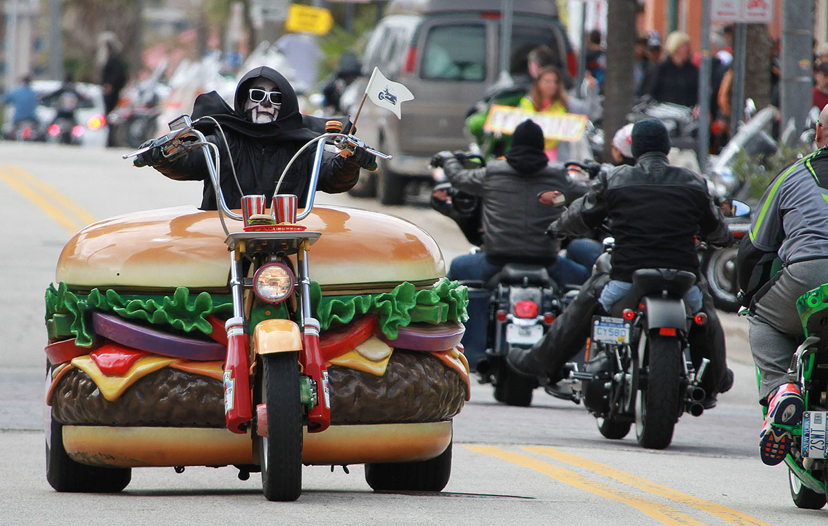 NEWS-JOURNAL/JIM TILLER Hamburger Harry riding his hamburger bike drew a lot of attention along Main Street in Daytona Beach as Bike Week 2014 enjoyed it\'s opening day Friday, March 7, 2014