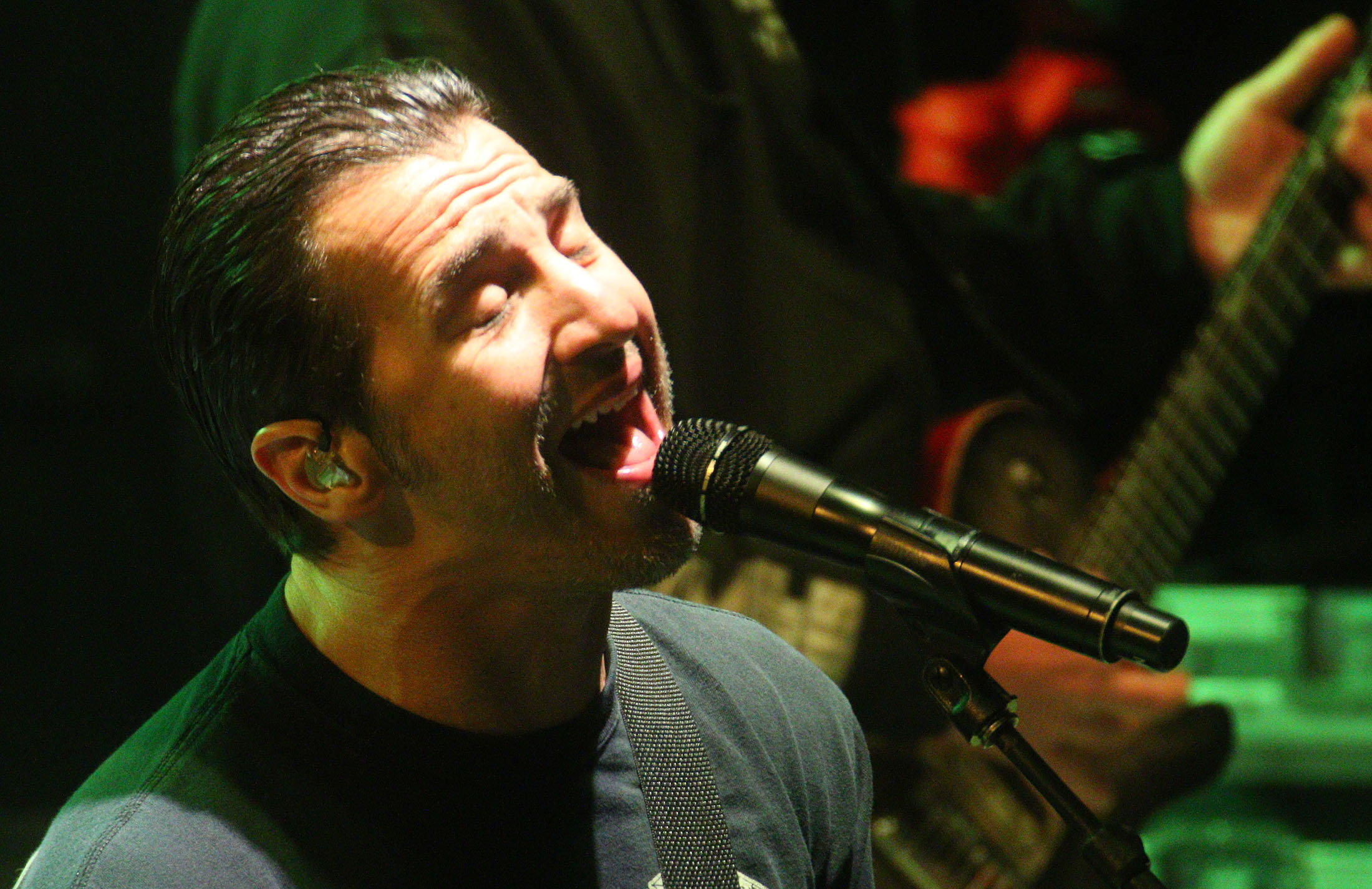 News-Journal/JIM TILLER   Lead singer Sully Erna from the band Godsmack belts out a song at the Full Moon Saloon lot Saturday night where the crowd grew so large that  Main Street had to be closed durning the concert.