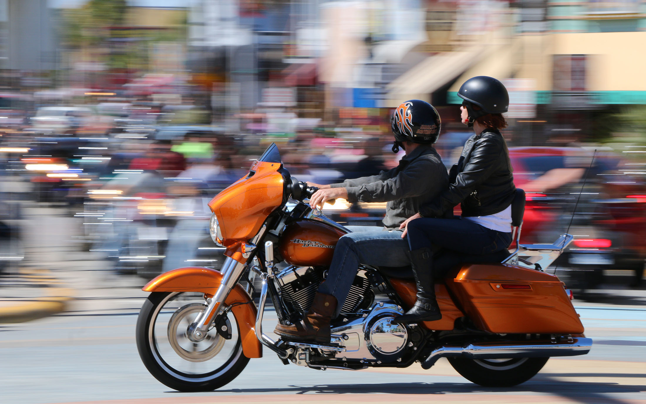 News-Journal/JIM TILLER A pair of bikers steak through the intersection of Main Street and A1A in Daytona Beach during Bike Week Monday, March 9, 2015.