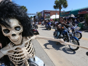 News-Journal/JIM TILLER  A skeleton on a parked motorcycle along Main Street in Daytona Beach was drawing a lot attention Monday, March 9, 2015 as Bike Week rolls on.