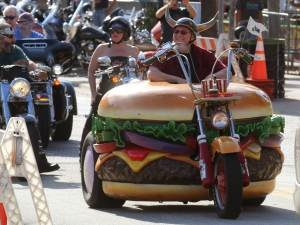 News-Journal/JIM TILLER   hamburger Harry drew a lot of attention as he road is hamburger bike along Main Street in Daytona Beach as Bike Week 2015 hits first gear Thursday, March 5, 2015.