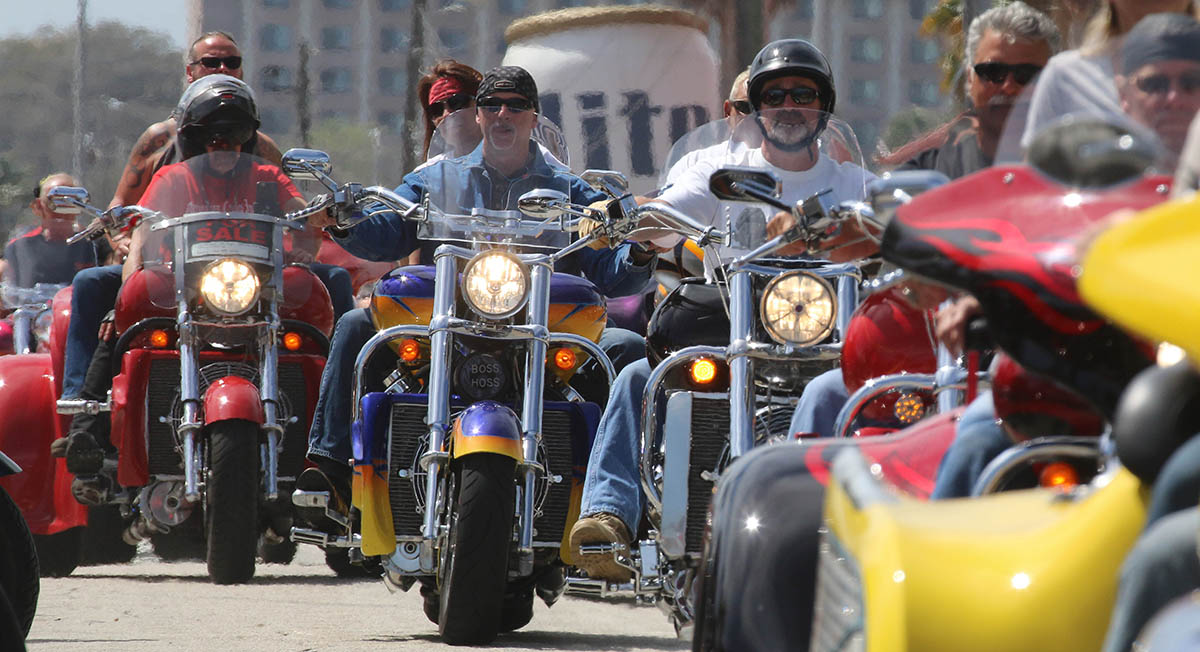 People along Main Street check out a three-wheeled-motorcycle parade  as Bike Week 2016 heads into it's final weekend in Daytona Beach Friday, March 11, 2016. News-Journal/JIM TILLER