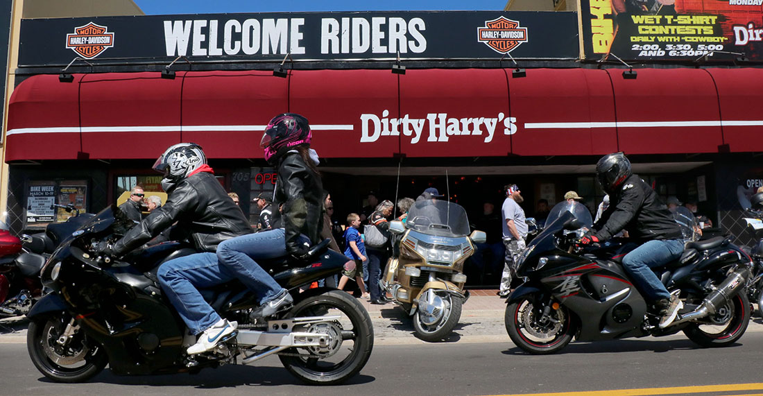 Biker pass Dirty Harry's bar on Main Street as bikers braved the cold temperatures during Bike Week Wednesday  March 15, 2017. [News-Journal/JIM TILLER ]