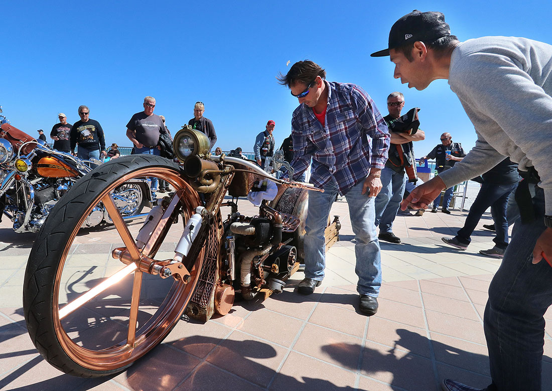 Bikers check out on of the many motorcycles on display at the 28th Annual boardwalk/Full Throttle Classic Bike Show in Daytona Beach Friday March 17,  2017. [News-Journal/JIM TILLER ]