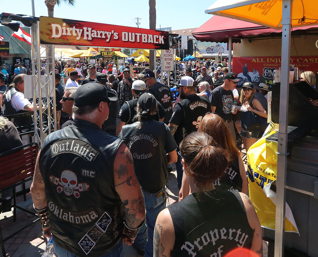 Members of the Outlaws Motorcycle Club head towards Main Street as Bike Week 2017 heads into it's last weekend in Daytona Beach Saturday March 18,  2017. [News-Journal/JIM TILLER ]