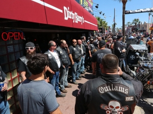 Daytona Beach Police keep an eye on  members of the Outlaws Motorcycle Club who showed up wearing their colors on Main Street in Daytona Beach Saturday March 18,  2017. [News-Journal/JIM TILLER ]