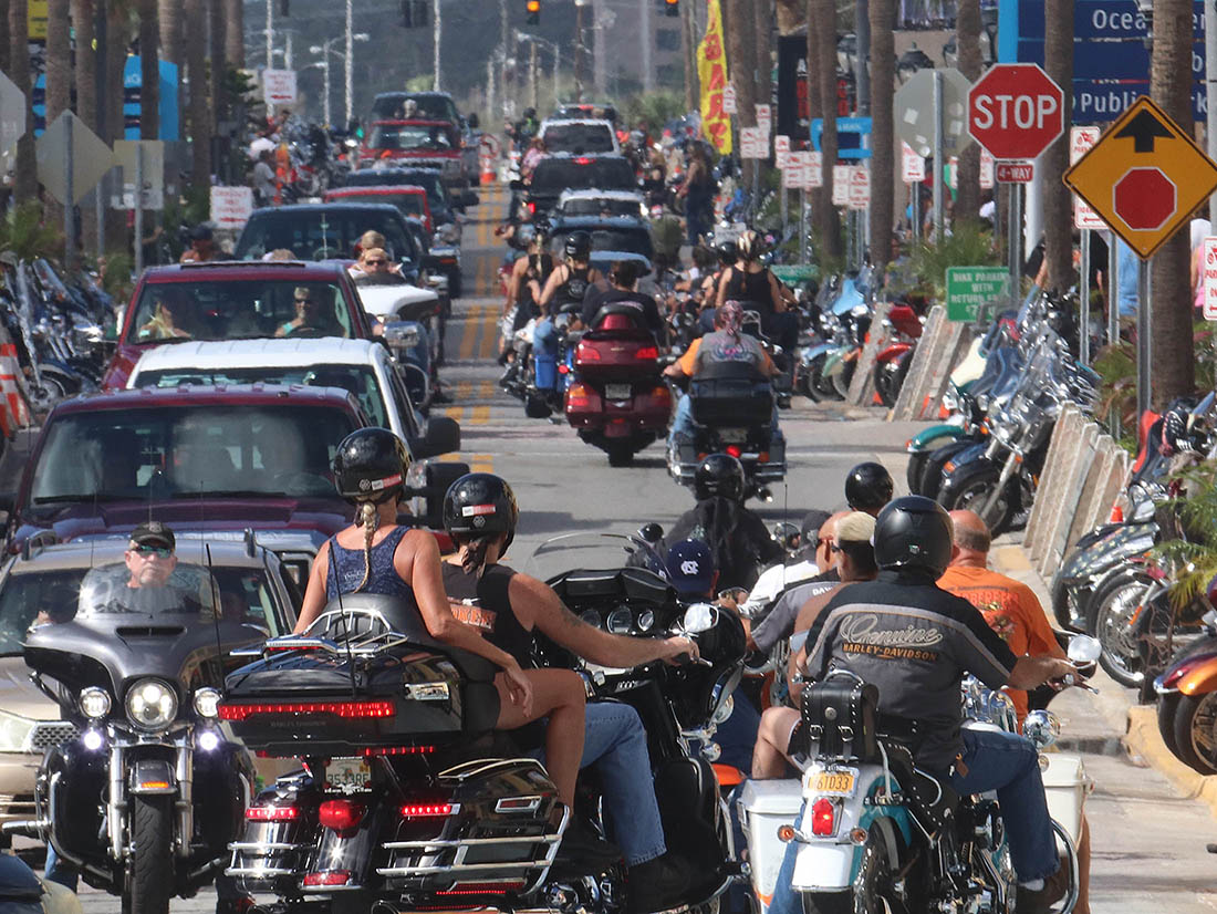 Bikers turn off A1A and onto Main Street as Biketoberfest heads into the weekend in Daytona Beach Friday October 20, 2017. [NEWS-JOURNAL/Jim Tiller]