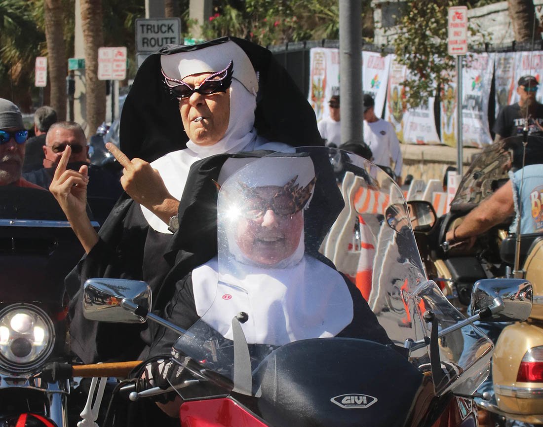 A pair of not-so-Catholic nuns ride down Main Street as Biketoberfest heads into the weekend in Daytona Beach Friday October 20, 2017. [NEWS-JOURNAL/Jim Tiller]