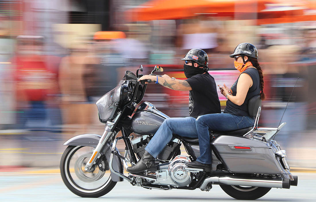 A couple streak south along A1A in as Biketoberfest heads into the weekend in Daytona Beach Friday October 20, 2017. [NEWS-JOURNAL/Jim Tiller]