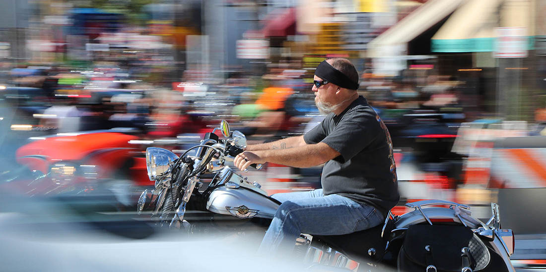 A biker streaks south on A1A as Biketoberfest heads into the weekend in Daytona Beach Friday October 20, 2017. [NEWS-JOURNAL/Jim Tiller]