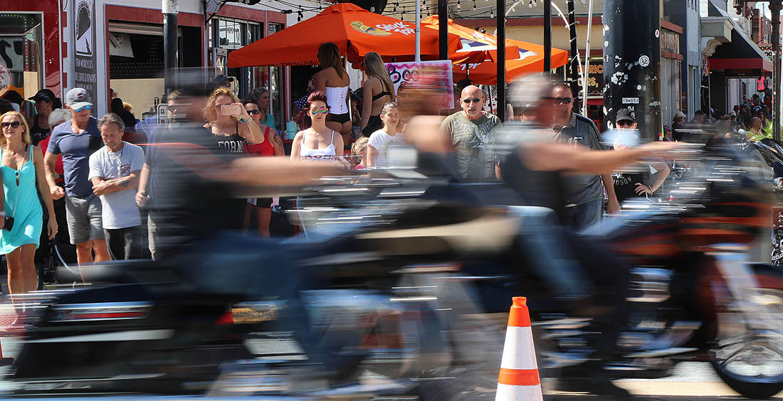 People waiting to cress A1A at Main Street watch as biker streak past as Biketoberfest heads into the weekend in Daytona Beach Friday October 20, 2017. [NEWS-JOURNAL/Jim Tiller]