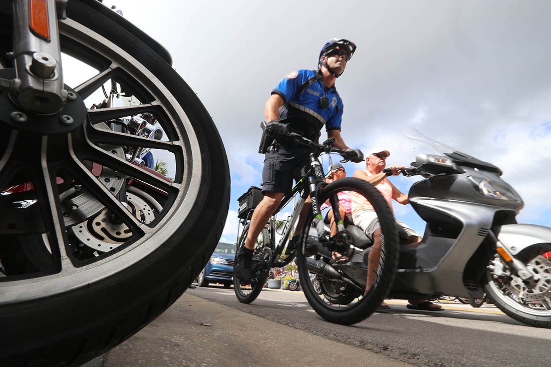 A police officer mixes in with the 2-wheeled crowd as Biketoberfest heads into the weekend in Daytona Beach Friday October 20, 2017. [NEWS-JOURNAL/Jim Tiller]