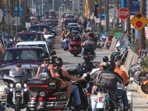 Bikers turn off A1A and onto Main Street as Biketoberfest heads into the weekend in Daytona Beach Friday October 20, 2017. [NEWS-JOURNAL/Jim Tiller]