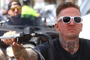 A well inked biker waits in traffic along Main Street as Biketoberfest heads into the weekend in Daytona Beach Friday October 20, 2017. [NEWS-JOURNAL/Jim Tiller]