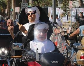 A pair of not-so-Catholic nuns ride down Main Street as Biketoberfest heads into the weekend in Daytona Beach Friday October 20, 2017. [NEWS-JOURNAL/Jim Tiller]